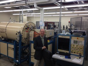 Standing in front of the ion acclerator at Accium Biosciences. Cesium ion source in background.